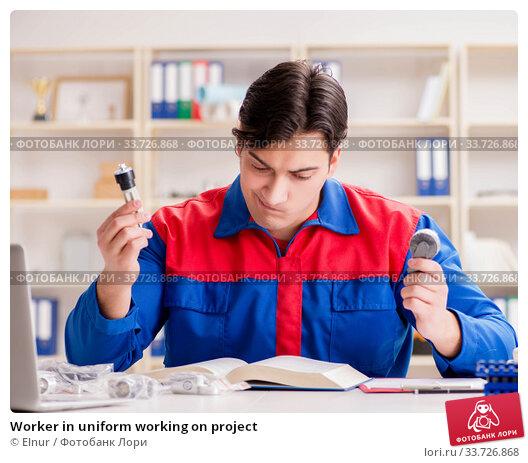 Купить «Worker in uniform working on project», фото № 33726868, снято 23 марта 2017 г. (c) Elnur / Фотобанк Лори