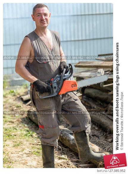 Купить «Working overalls and boots sawing logs using chainsaws», фото № 27385952, снято 12 июня 2015 г. (c) Евгений Ткачёв / Фотобанк Лори