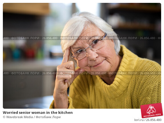Купить «Worried senior woman in the kitchen», фото № 26856480, снято 25 мая 2017 г. (c) Wavebreak Media / Фотобанк Лори