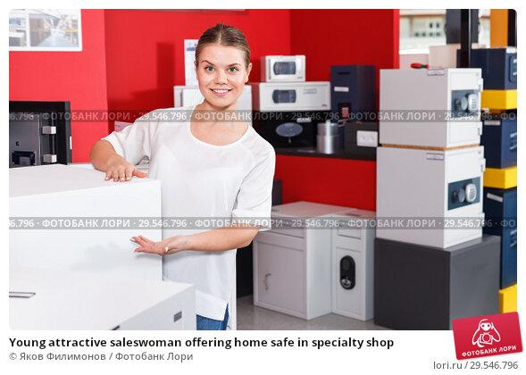 Купить «Young attractive saleswoman offering home safe in specialty shop», фото № 29546796, снято 17 апреля 2018 г. (c) Яков Филимонов / Фотобанк Лори