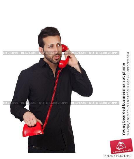 Young bearded businessman at phone. Стоковое фото, фотограф Gelpi José Manuel / PantherMedia / Фотобанк Лори