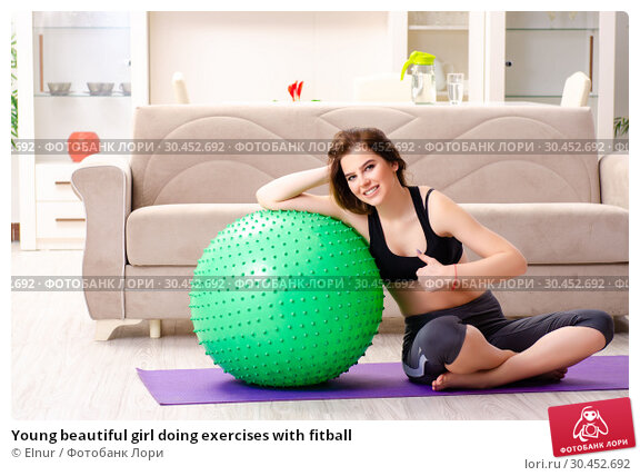 Young beautiful girl doing exercises with fitball. Стоковое фото, фотограф Elnur / Фотобанк Лори