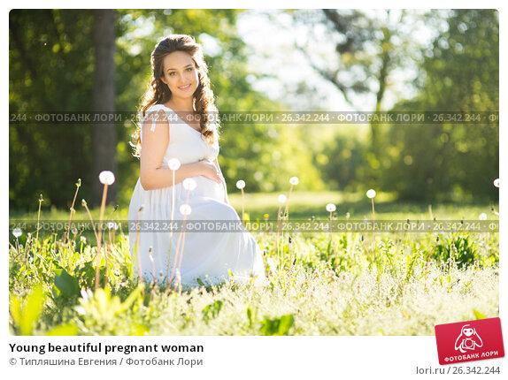 Купить «Young beautiful pregnant woman», фото № 26342244, снято 27 апреля 2017 г. (c) Типляшина Евгения / Фотобанк Лори