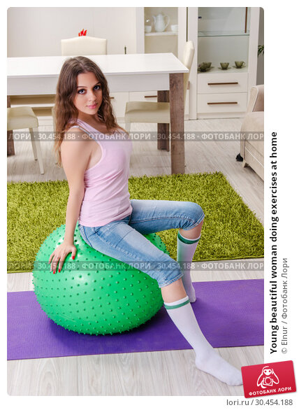 Young beautiful woman doing exercises at home. Стоковое фото, фотограф Elnur / Фотобанк Лори