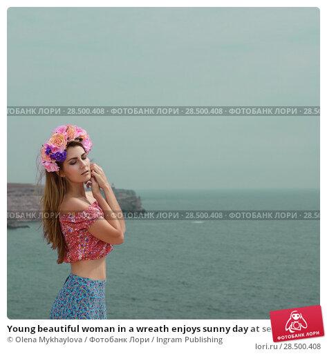 Купить «Young beautiful woman in a wreath enjoys sunny day at sea shore», фото № 28500408, снято 13 сентября 2013 г. (c) Ingram Publishing / Фотобанк Лори