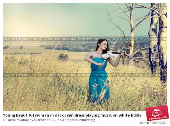Купить «Young beautiful woman in dark cyan dress playing music on white fiddle», фото № 28500424, снято 30 июля 2013 г. (c) Ingram Publishing / Фотобанк Лори