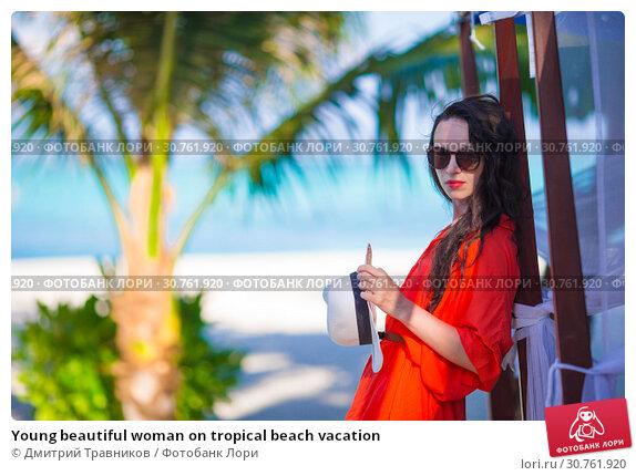 Купить «Young beautiful woman on tropical beach vacation», фото № 30761920, снято 31 марта 2015 г. (c) Дмитрий Травников / Фотобанк Лори