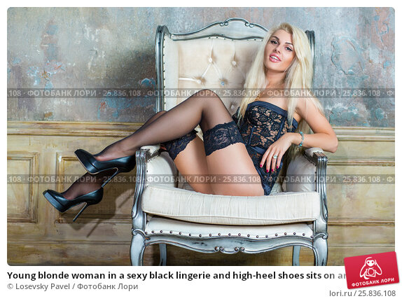 Купить «Young blonde woman in a sexy black lingerie and high-heel shoes sits on armchair in empty room», фото № 25836108, снято 17 сентября 2015 г. (c) Losevsky Pavel / Фотобанк Лори
