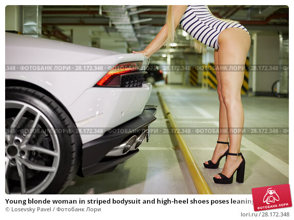 Купить «Young blonde woman in striped bodysuit and high-heel shoes poses leaning hands on trunk of modern white car at underground parking», фото № 28172348, снято 2 июня 2016 г. (c) Losevsky Pavel / Фотобанк Лори