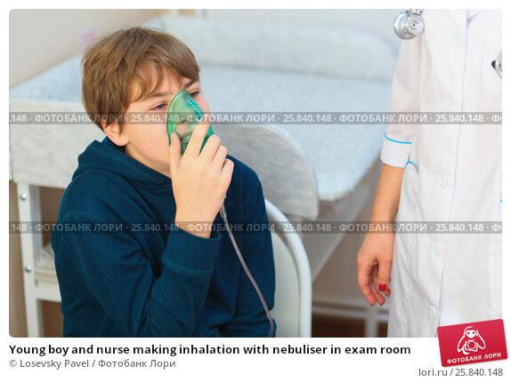 Купить «Young boy and nurse making inhalation with nebuliser in exam room», фото № 25840148, снято 29 ноября 2014 г. (c) Losevsky Pavel / Фотобанк Лори
