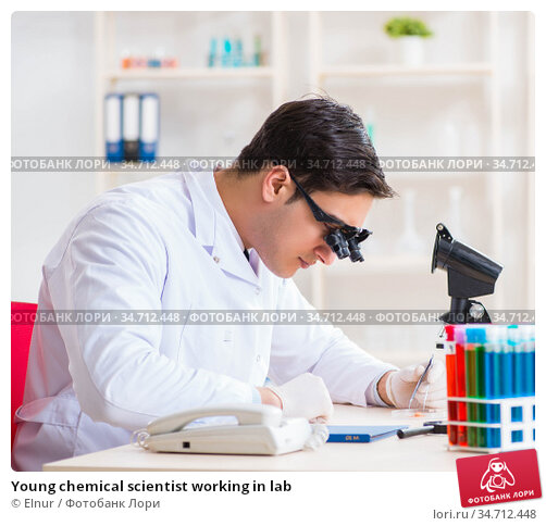 Young chemical scientist working in lab. Стоковое фото, фотограф Elnur / Фотобанк Лори
