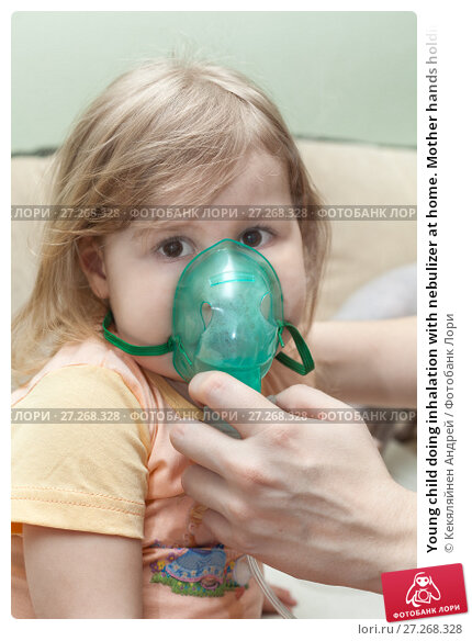 Купить «Young child doing inhalation with nebulizer at home. Mother hands holding mask», фото № 27268328, снято 15 апреля 2011 г. (c) Кекяляйнен Андрей / Фотобанк Лори