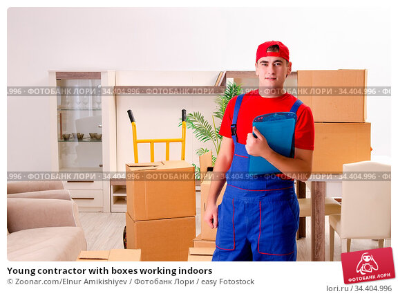 Young contractor with boxes working indoors. Стоковое фото, фотограф Zoonar.com/Elnur Amikishiyev / easy Fotostock / Фотобанк Лори