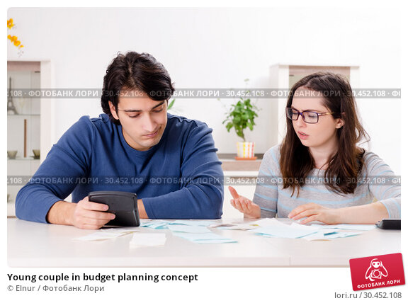Young couple in budget planning concept. Стоковое фото, фотограф Elnur / Фотобанк Лори