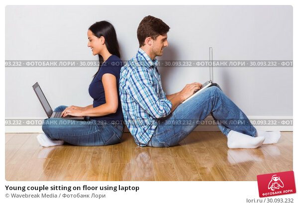 Купить «Young couple sitting on floor using laptop», фото № 30093232, снято 2 июля 2014 г. (c) Wavebreak Media / Фотобанк Лори