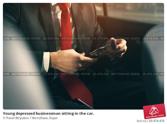 Купить «Young depressed businessman sitting in the car.», фото № 29474416, снято 8 ноября 2018 г. (c) Pavel Biryukov / Фотобанк Лори