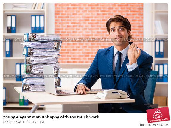 Купить «Young elegant man unhappy with too much work», фото № 29825108, снято 14 сентября 2018 г. (c) Elnur / Фотобанк Лори