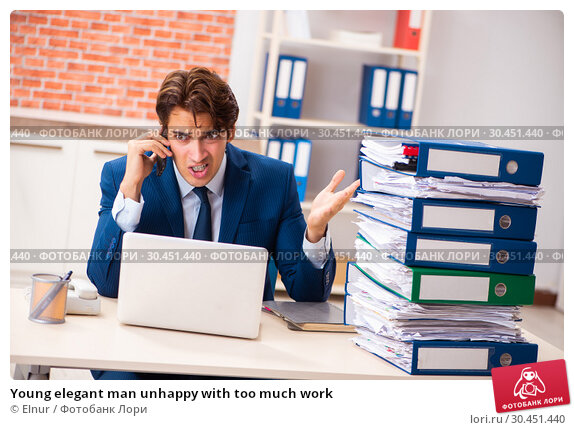 Young elegant man unhappy with too much work. Стоковое фото, фотограф Elnur / Фотобанк Лори