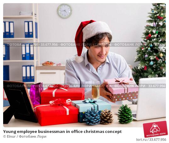 Купить «Young employee businessman in office christmas concept», фото № 33677956, снято 18 июля 2018 г. (c) Elnur / Фотобанк Лори