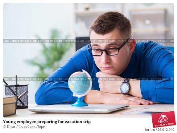 Купить «Young employee preparing for vacation trip», фото № 29012040, снято 2 февраля 2018 г. (c) Elnur / Фотобанк Лори