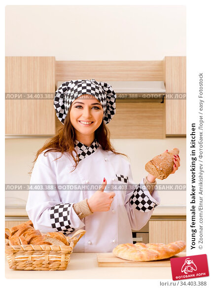 Young female baker working in kitchen. Стоковое фото, фотограф Zoonar.com/Elnur Amikishiyev / easy Fotostock / Фотобанк Лори