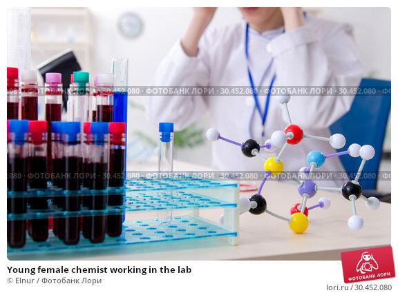 Young female chemist working in the lab. Стоковое фото, фотограф Elnur / Фотобанк Лори