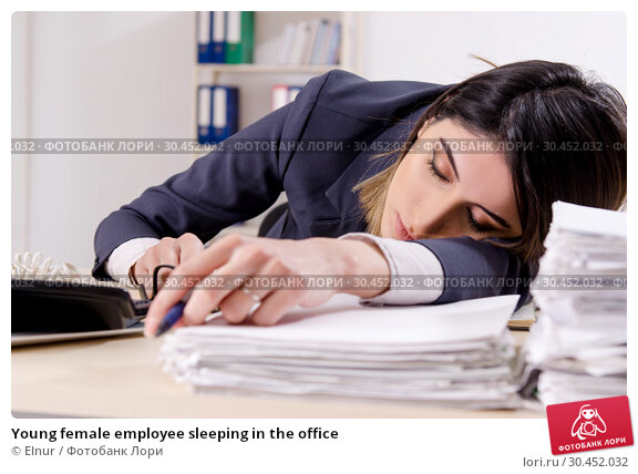 Young female employee sleeping in the office. Стоковое фото, фотограф Elnur / Фотобанк Лори