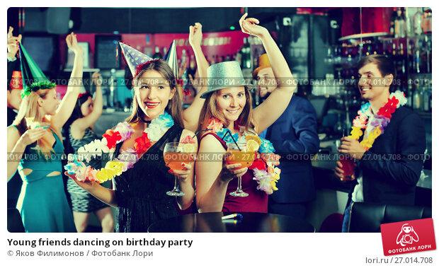 Купить «Young friends dancing on birthday party», фото № 27014708, снято 20 апреля 2017 г. (c) Яков Филимонов / Фотобанк Лори