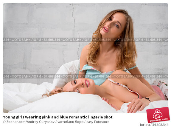 Young girls wearing pink and blue romantic lingerie shot. Стоковое фото, фотограф Zoonar.com/Andrey Guryanov / easy Fotostock / Фотобанк Лори