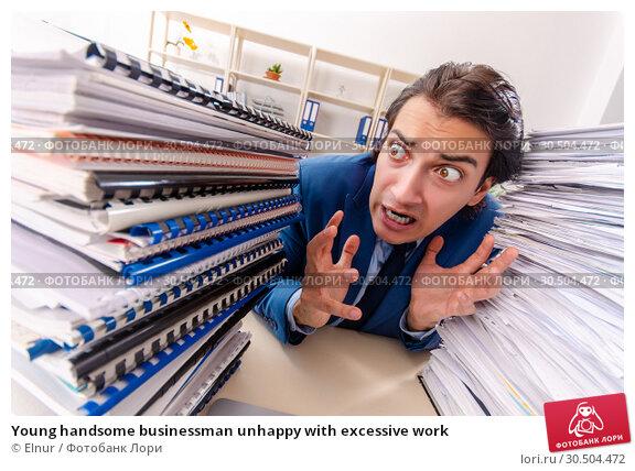 Купить «Young handsome businessman unhappy with excessive work», фото № 30504472, снято 15 декабря 2018 г. (c) Elnur / Фотобанк Лори