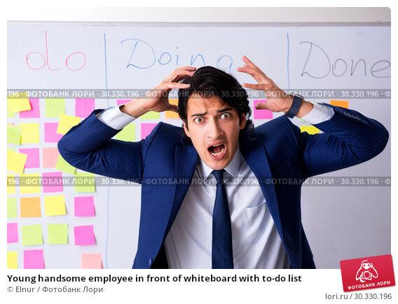 Купить «Young handsome employee in front of whiteboard with to-do list», фото № 30330196, снято 16 октября 2018 г. (c) Elnur / Фотобанк Лори