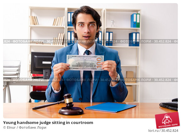 Young handsome judge sitting in courtroom. Стоковое фото, фотограф Elnur / Фотобанк Лори