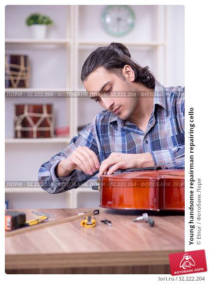 Купить «Young handsome repairman repairing cello», фото № 32222204, снято 4 апреля 2019 г. (c) Elnur / Фотобанк Лори