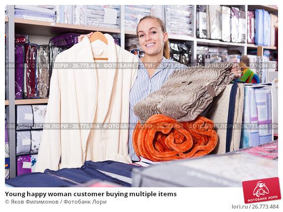 Young happy woman customer buying multiple items, фото № 26773484, снято 26 сентября 2017 г. (c) Яков Филимонов / Фотобанк Лори