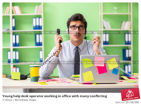 Купить «Young help desk operator working in office with many conflicting», фото № 29138996, снято 18 мая 2018 г. (c) Elnur / Фотобанк Лори