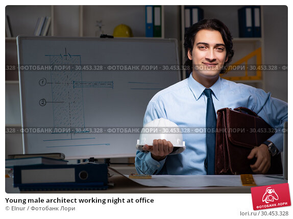 Young male architect working night at office. Стоковое фото, фотограф Elnur / Фотобанк Лори