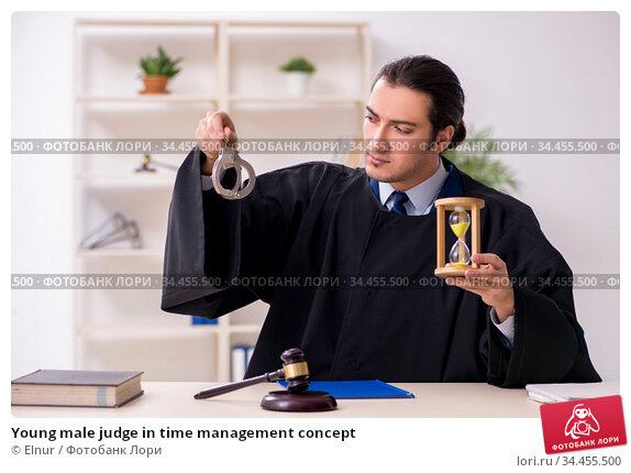 Young male judge in time management concept. Стоковое фото, фотограф Elnur / Фотобанк Лори