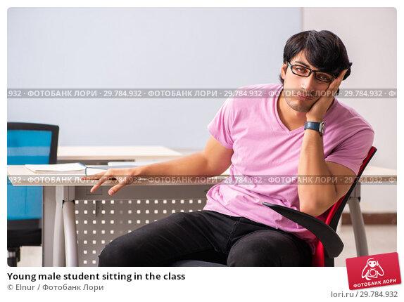 Купить «Young male student sitting in the class», фото № 29784932, снято 8 октября 2018 г. (c) Elnur / Фотобанк Лори