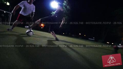 Купить «Young man leads the ball on a green field, other players are trying to take away his ball», видеоролик № 28926748, снято 20 августа 2018 г. (c) Константин Шишкин / Фотобанк Лори