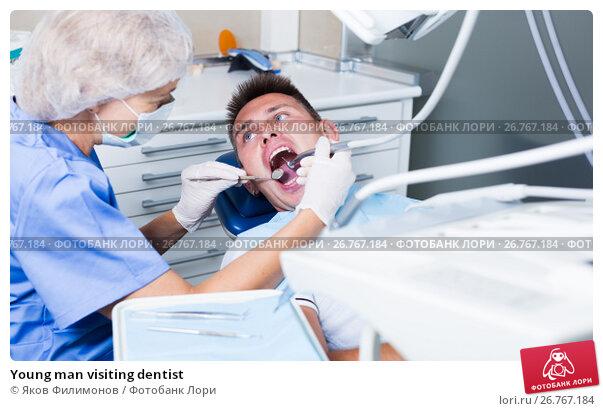 Купить «Young man visiting dentist», фото № 26767184, снято 5 июля 2017 г. (c) Яков Филимонов / Фотобанк Лори