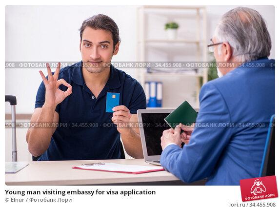 Young man visiting embassy for visa application. Стоковое фото, фотограф Elnur / Фотобанк Лори