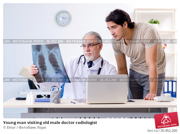 Young man visiting old male doctor radiologist. Стоковое фото, фотограф Elnur / Фотобанк Лори