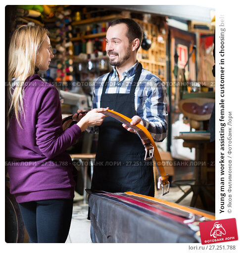 Купить «Young man worker assisting female customer in choosing belt», фото № 27251788, снято 19 февраля 2019 г. (c) Яков Филимонов / Фотобанк Лори