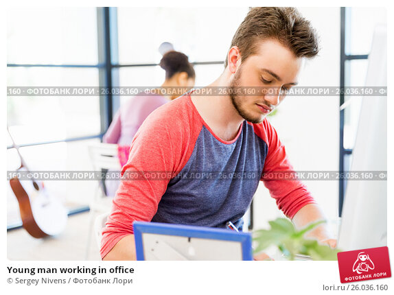 Young man working in office, фото № 26036160, снято 13 декабря 2014 г. (c) Sergey Nivens / Фотобанк Лори