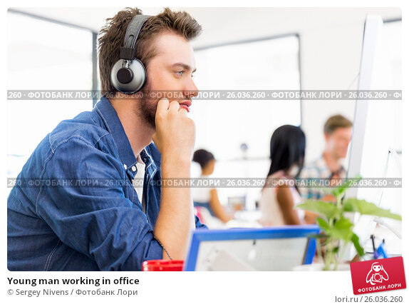 Young man working in office, фото № 26036260, снято 13 декабря 2014 г. (c) Sergey Nivens / Фотобанк Лори