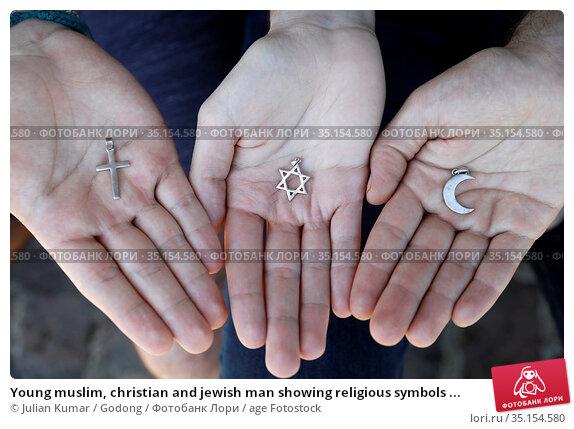 Young muslim, christian and jewish man showing religious symbols ... Стоковое фото, фотограф Julian Kumar / Godong / age Fotostock / Фотобанк Лори