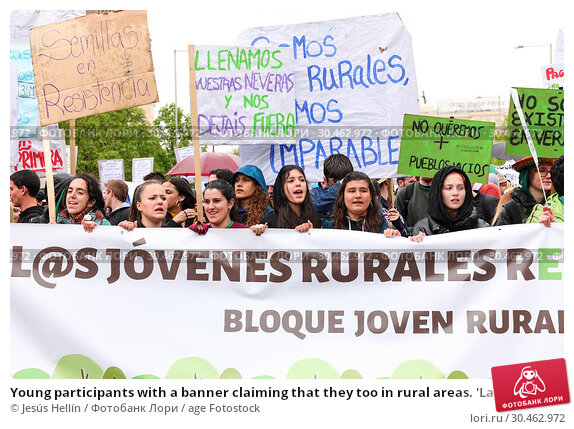 Young participants with a banner claiming that they too in rural areas. 'La Revuelta de la España Vaciada' from the Plaza de Colón in Madrid to Neptuno... (2019 год). Редакционное фото, фотограф Jesús Hellín / age Fotostock / Фотобанк Лори