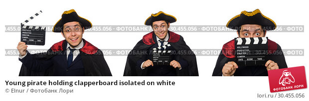 Young pirate holding clapperboard isolated on white. Стоковое фото, фотограф Elnur / Фотобанк Лори