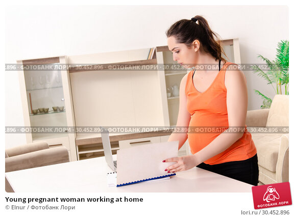 Young pregnant woman working at home. Стоковое фото, фотограф Elnur / Фотобанк Лори