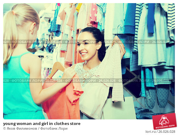 young woman and girl in clothes store, фото № 26026028, снято 27 июня 2017 г. (c) Яков Филимонов / Фотобанк Лори
